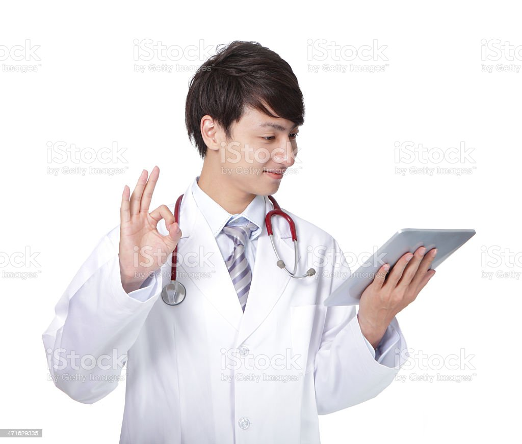 Doctor showing ok hand sign with tablet pc royalty-free stock photo