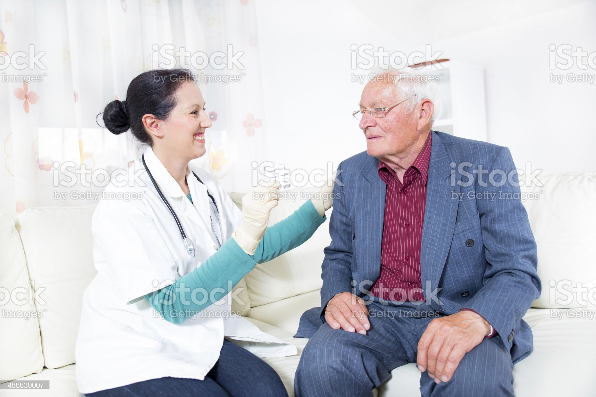 Doctor showing pills to her patient royalty-free stock photo