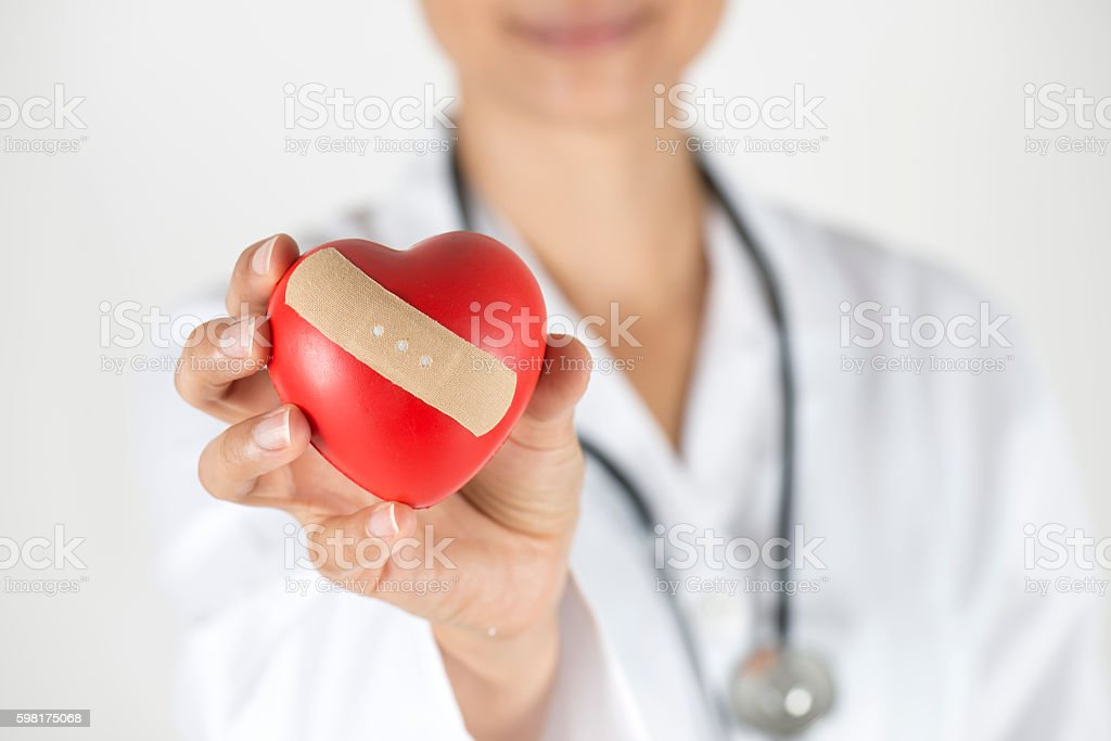 Doctor Showing Red Heart Shape stock photo