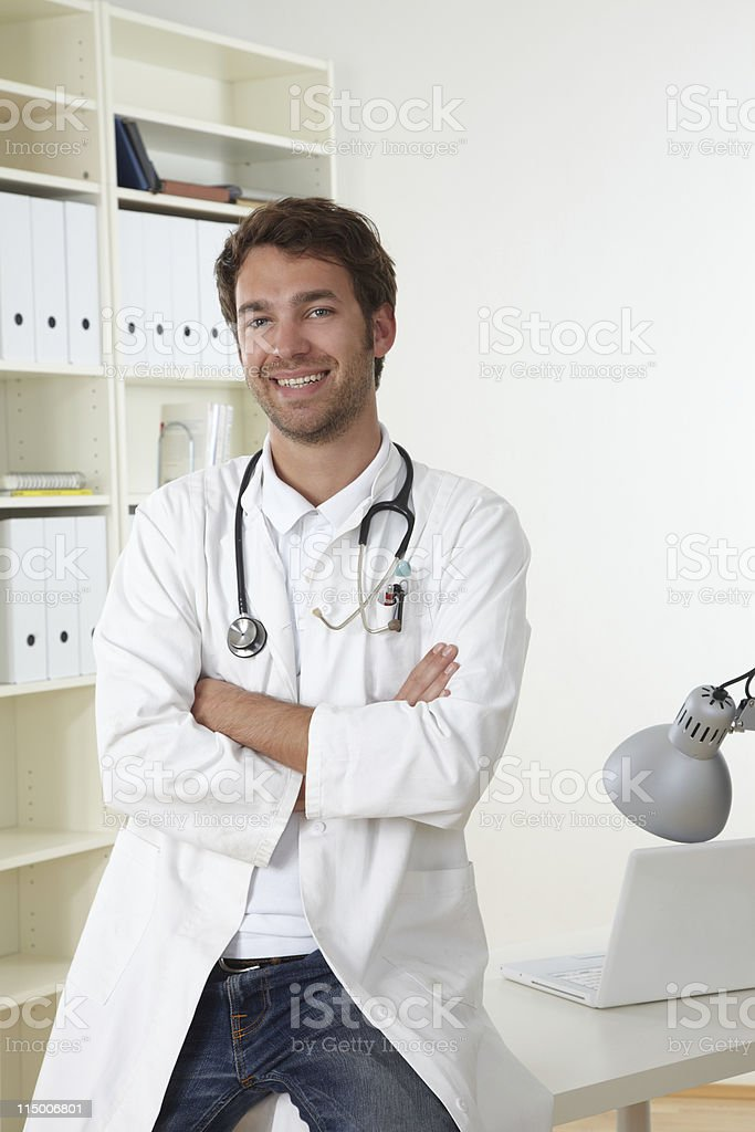 Doctor sits in office stock photo