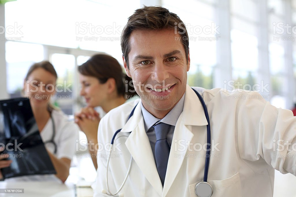 Doctor sitting in office stock photo