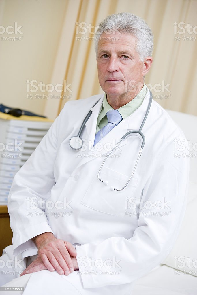 Doctor Sitting On A Hospital Bed royalty-free stock photo