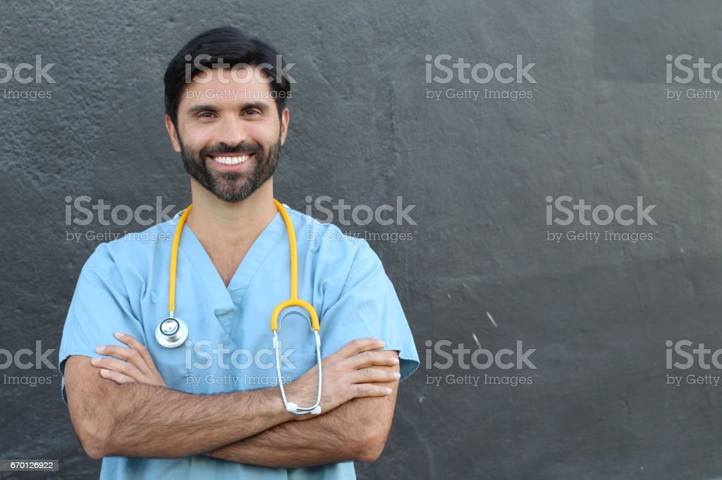 Doctor smiling with arms crossed and copyspace stock photo
