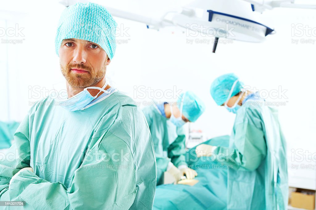 Doctor standing in an operating room royalty-free stock photo