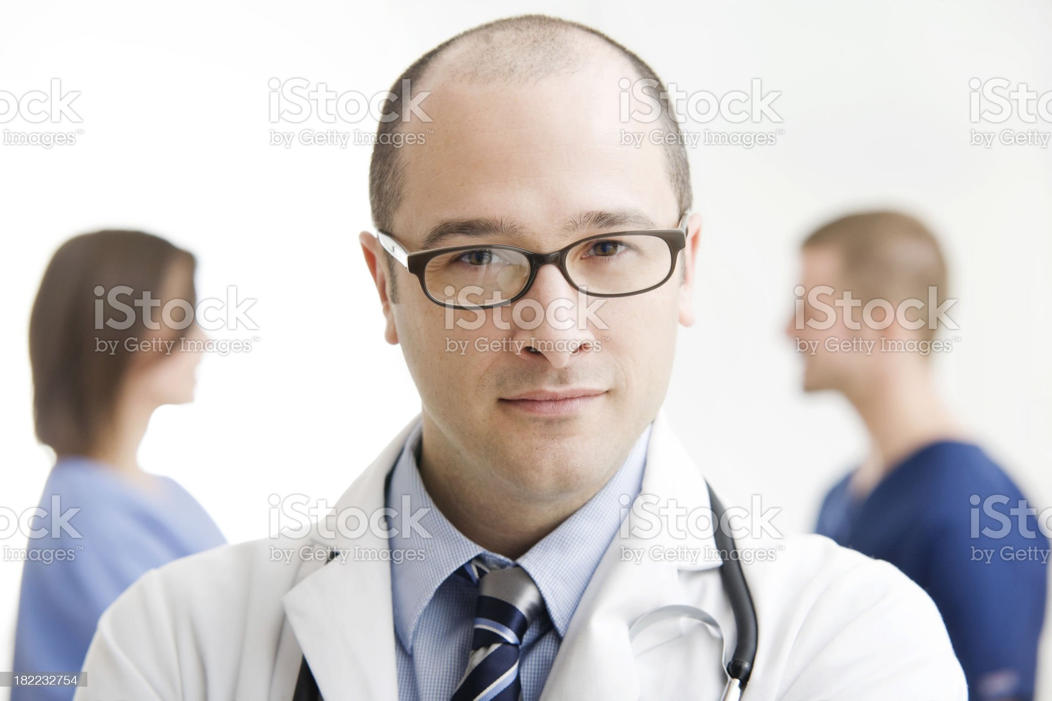 Doctor Standing with Medical Team royalty-free stock photo