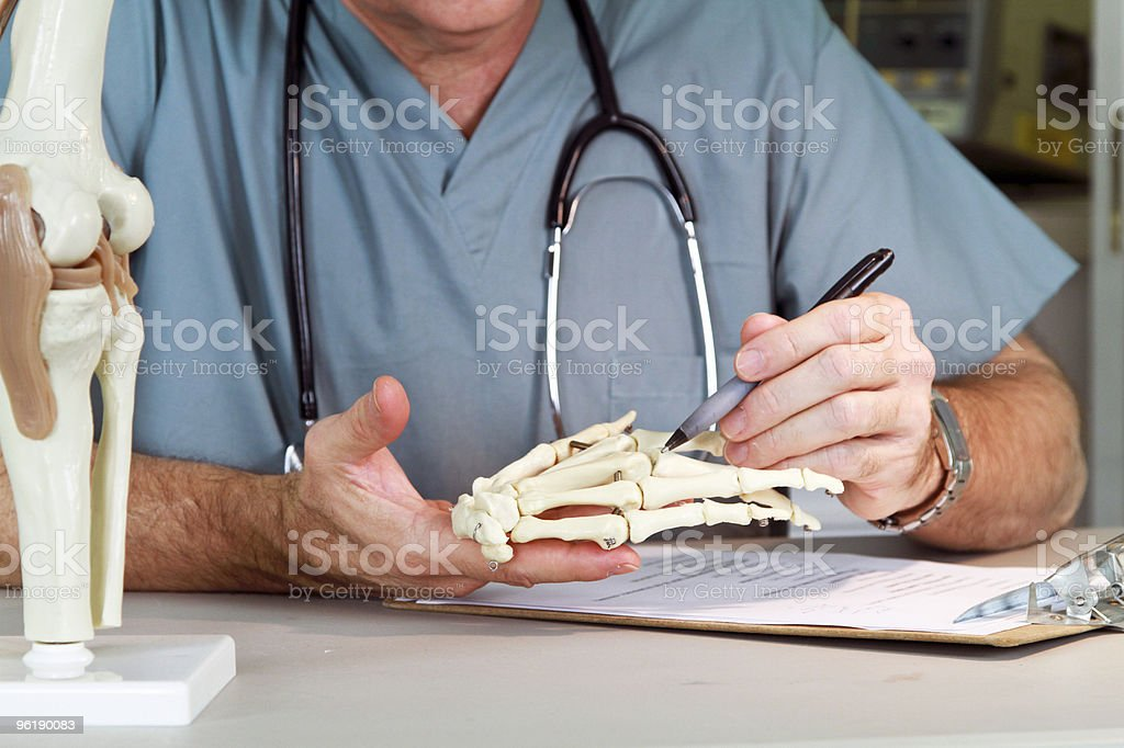doctor studying a hand joint royalty-free stock photo