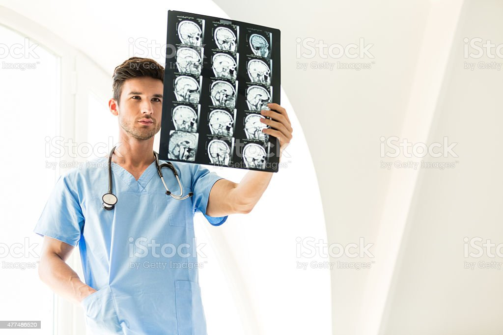 Doctor Studying An MRI Scan Of The Brain stock photo