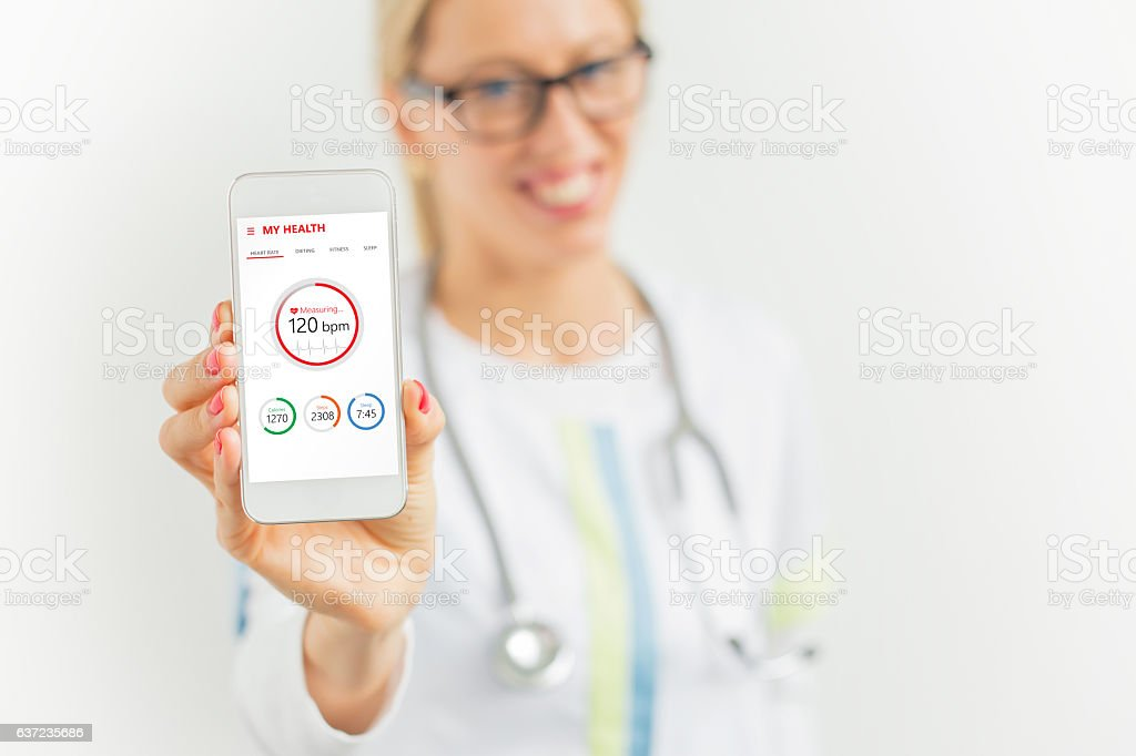 Doctor suggesting to use health app stock photo