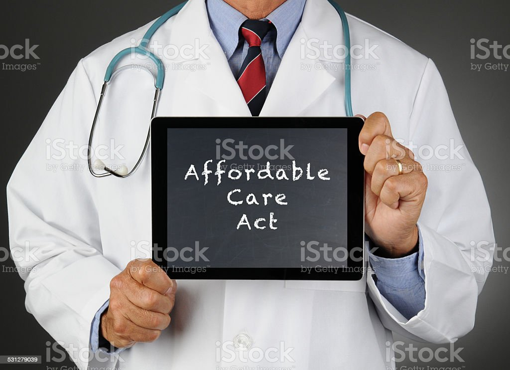 Doctor Tablet Computer Affordable Care Act stock photo
