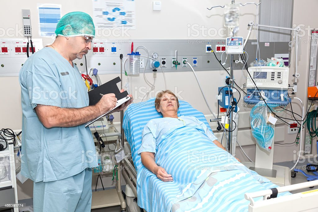 Doctor takes notes about patient's state of health stock photo