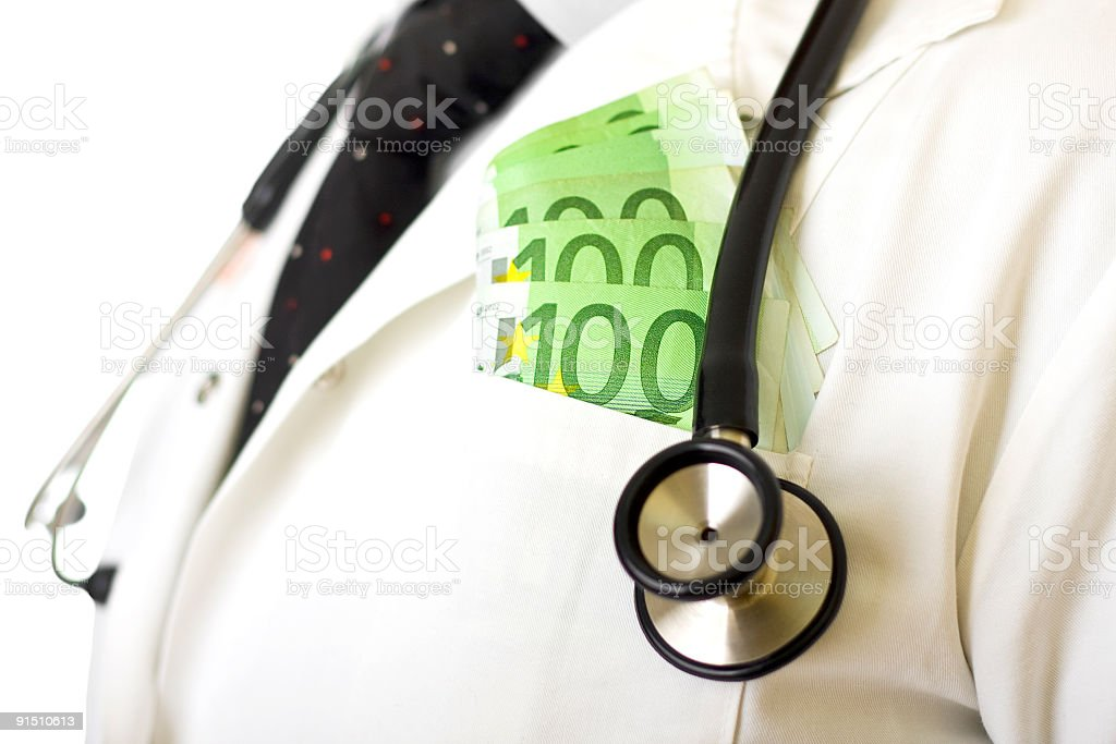 Doctor taking bribe royalty-free stock photo