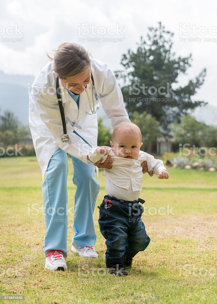 Doctor taking care of a baby stock photo