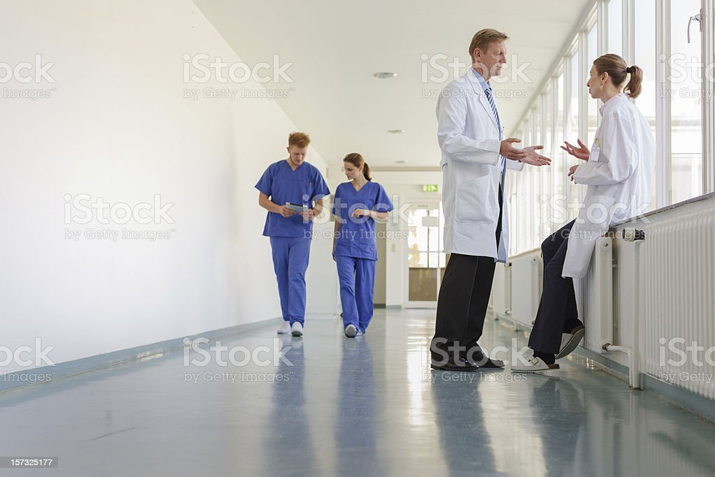 Doctor taking in Hallway stock photo
