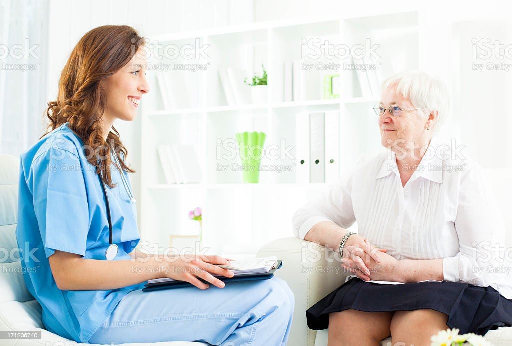 Doctor Taking Notes from Senior Woman patient. royalty-free stock photo