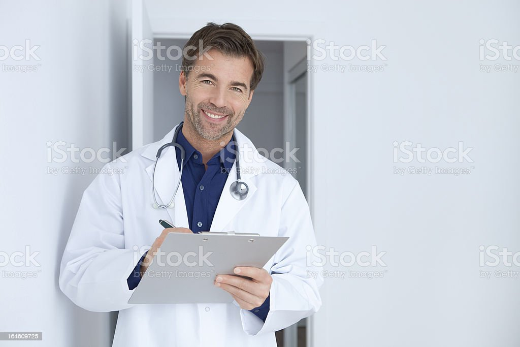 Doctor Taking Notes When Visiting His Patient royalty-free stock photo