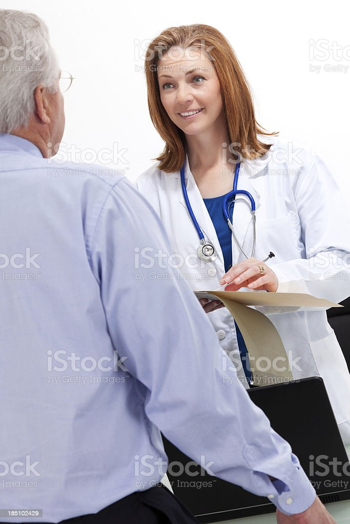Doctor taking notes while meeting with patient royalty-free stock photo