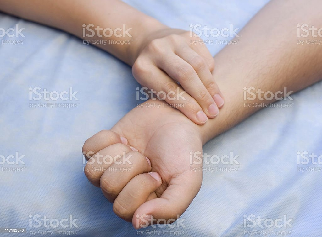 Doctor taking patient's pulse. stock photo