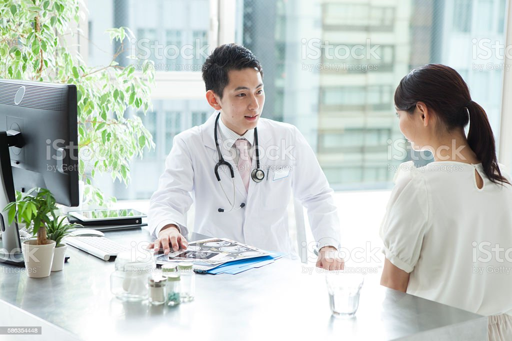 Doctor talking about  results of brain examination in patient stock photo