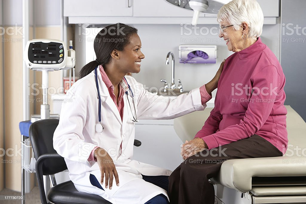 Doctor talking to a elderly female patient stock photo