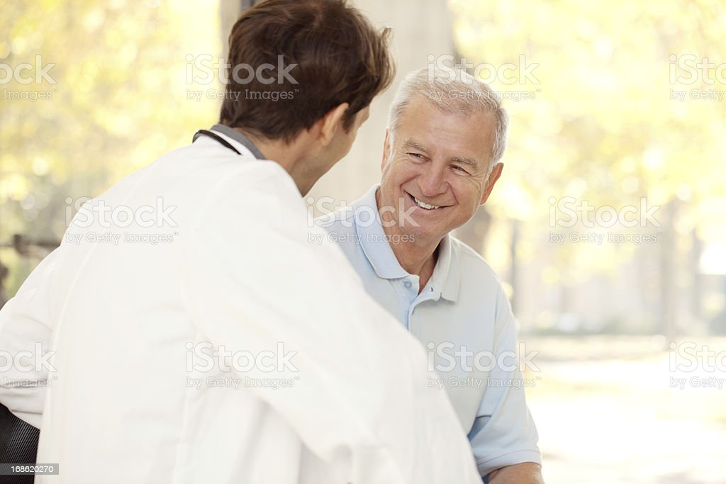 Doctor talking to a patient at the hospital royalty-free stock photo