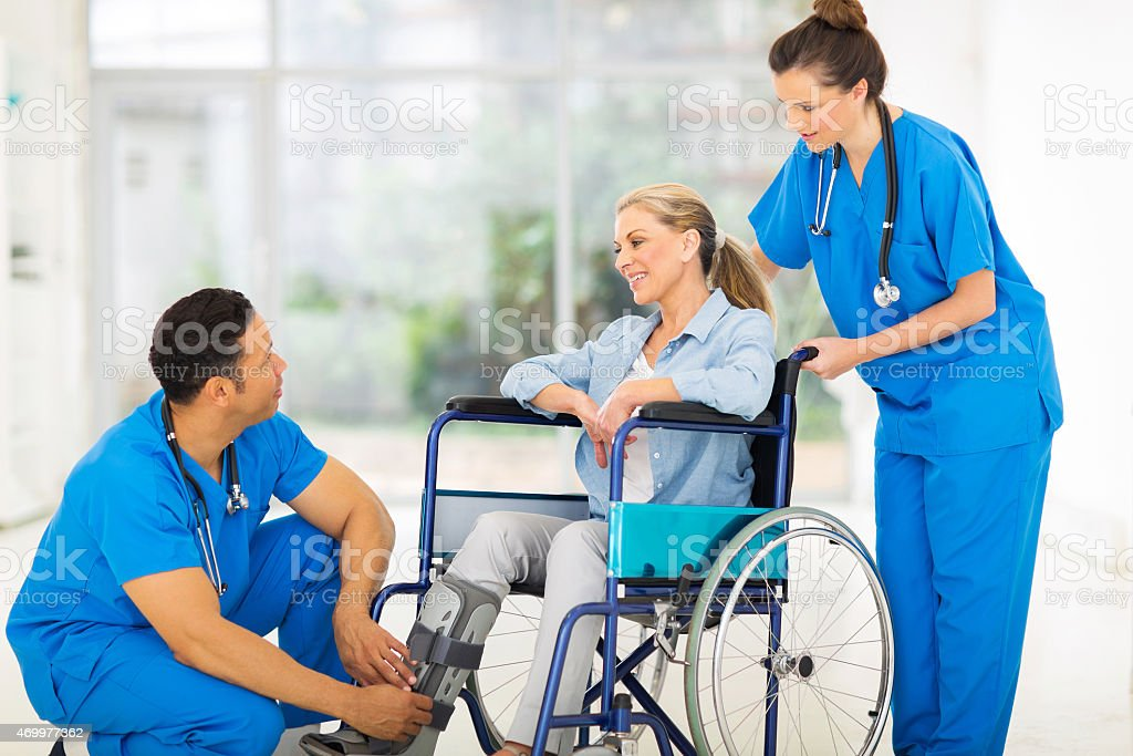 doctor talking to a recovering patient in wheelchair stock photo
