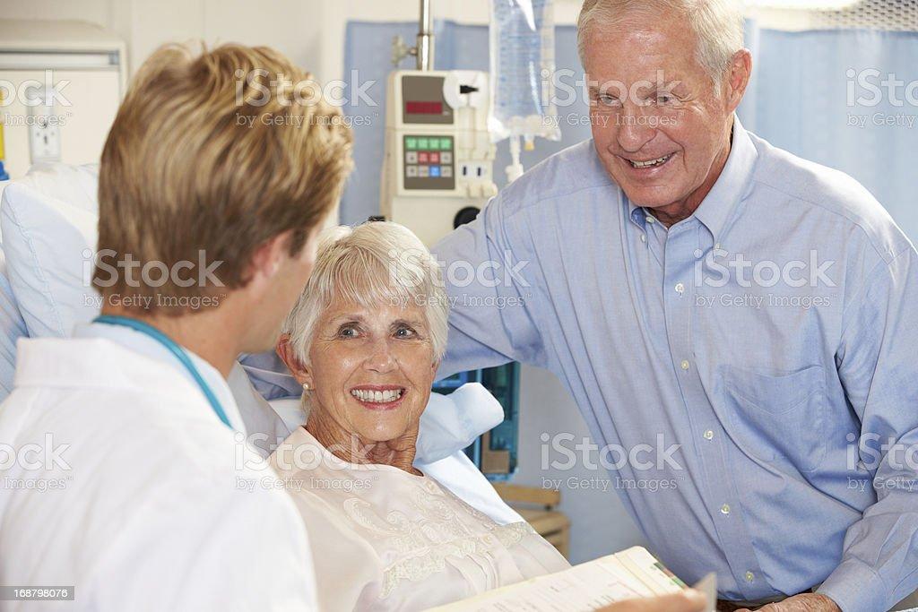 Doctor talking to a senior couple royalty-free stock photo
