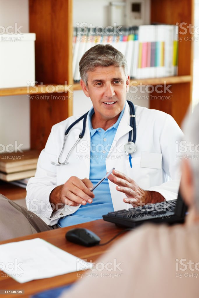 Doctor talking to his patient royalty-free stock photo