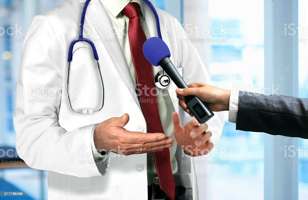 Doctor Talking to Microphone stock photo