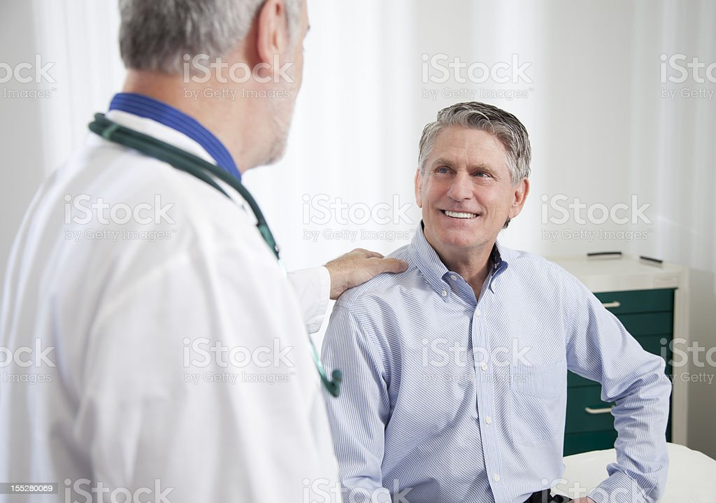 Doctor Talking To Patient stock photo