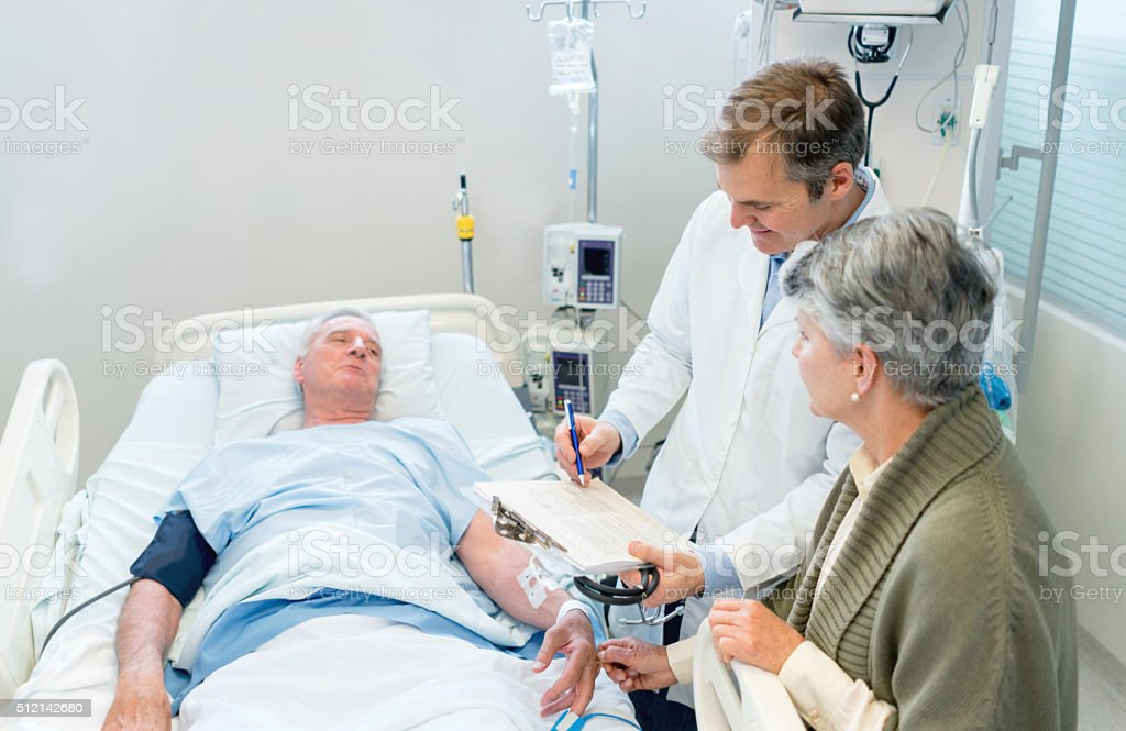 Doctor talking to patient's family at the hospital stock photo
