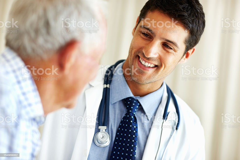 Doctor talking to senior patient royalty-free stock photo