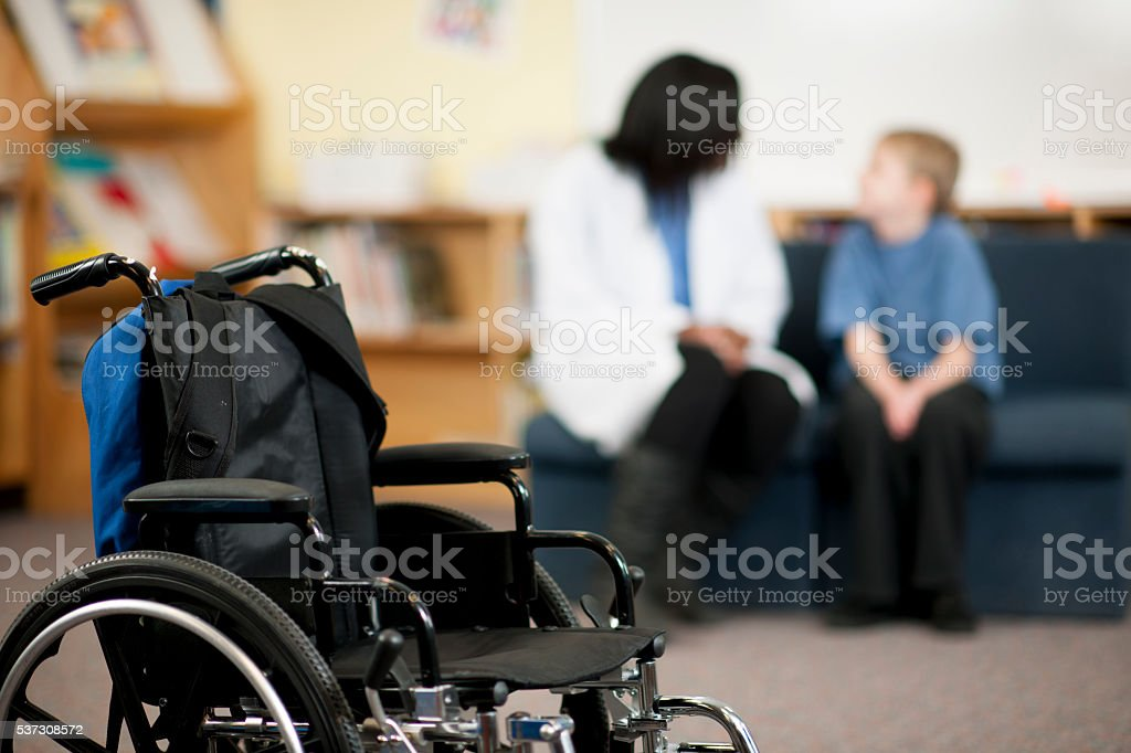 Doctor Talking with a Child stock photo