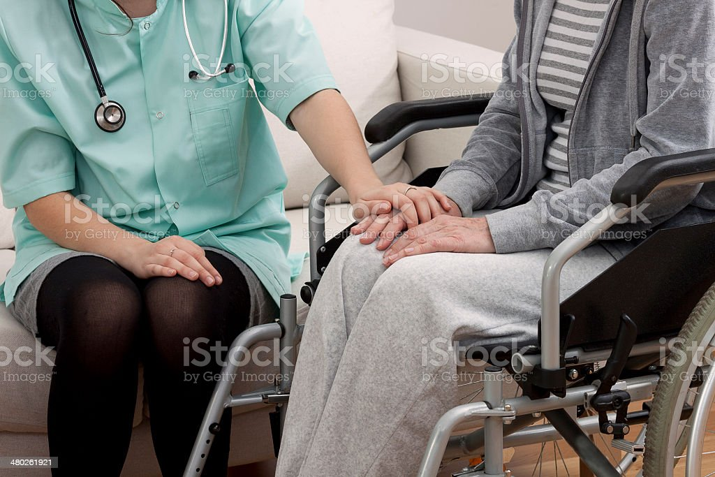 Doctor talking with aged patient stock photo