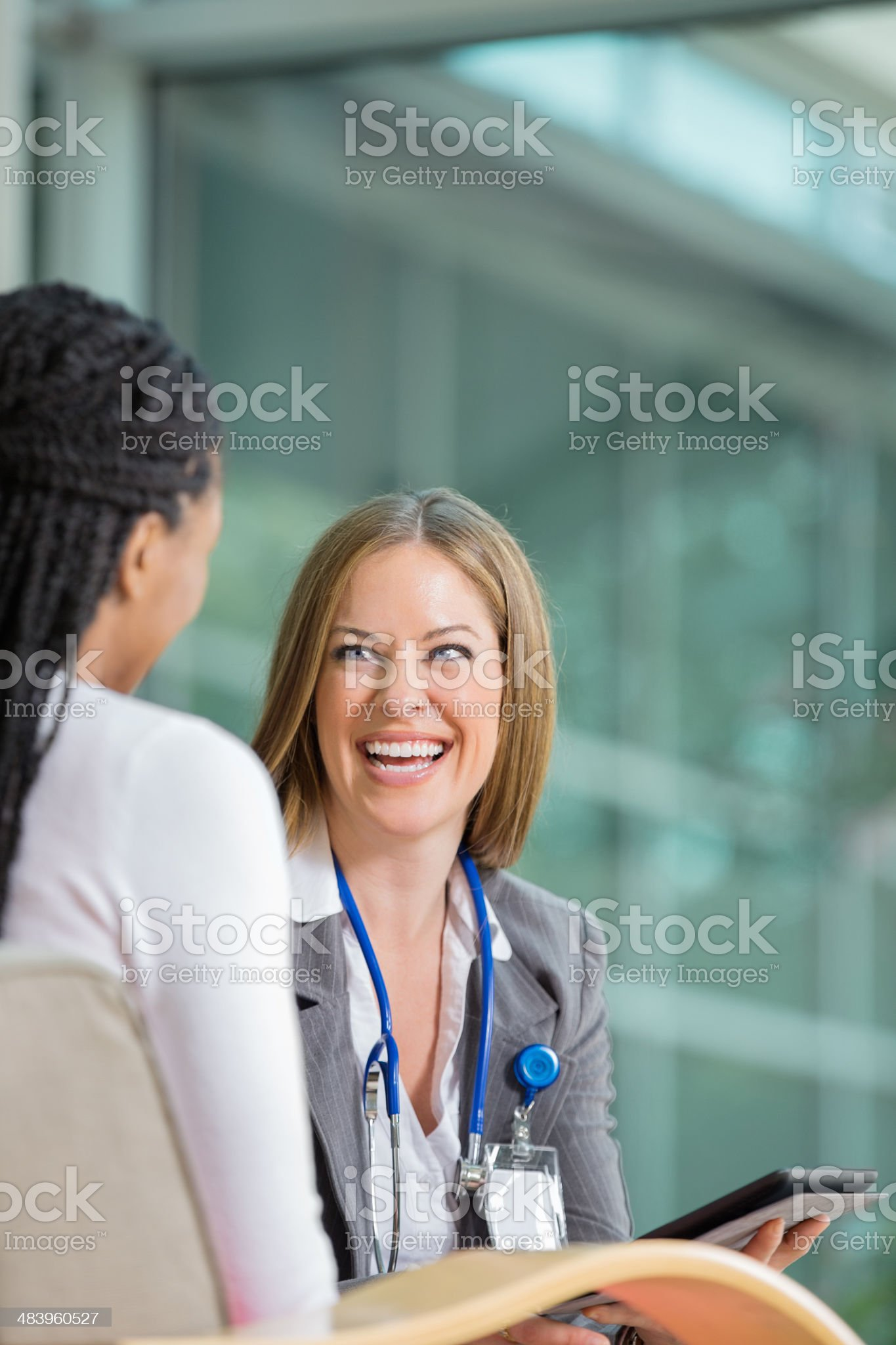 Doctor talking with female patient in office royalty-free stock photo