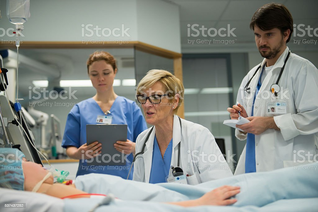 Doctor talking with patient stock photo