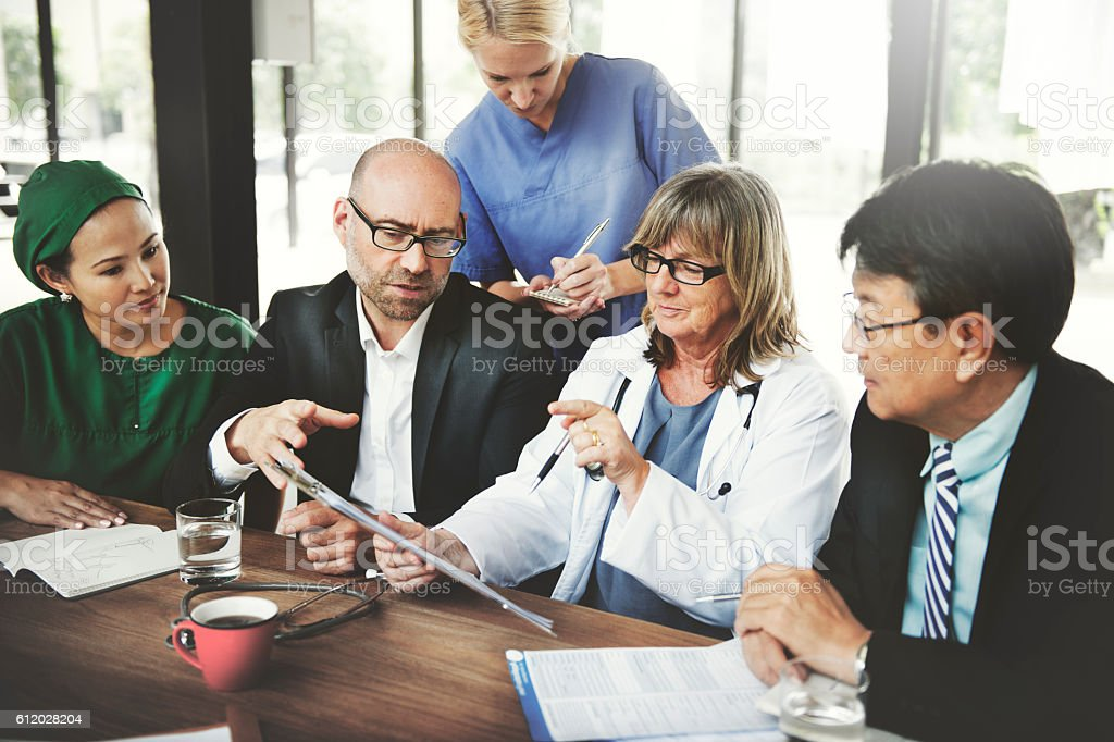 Doctor Team Treatment Plan Discussion Concept stock photo