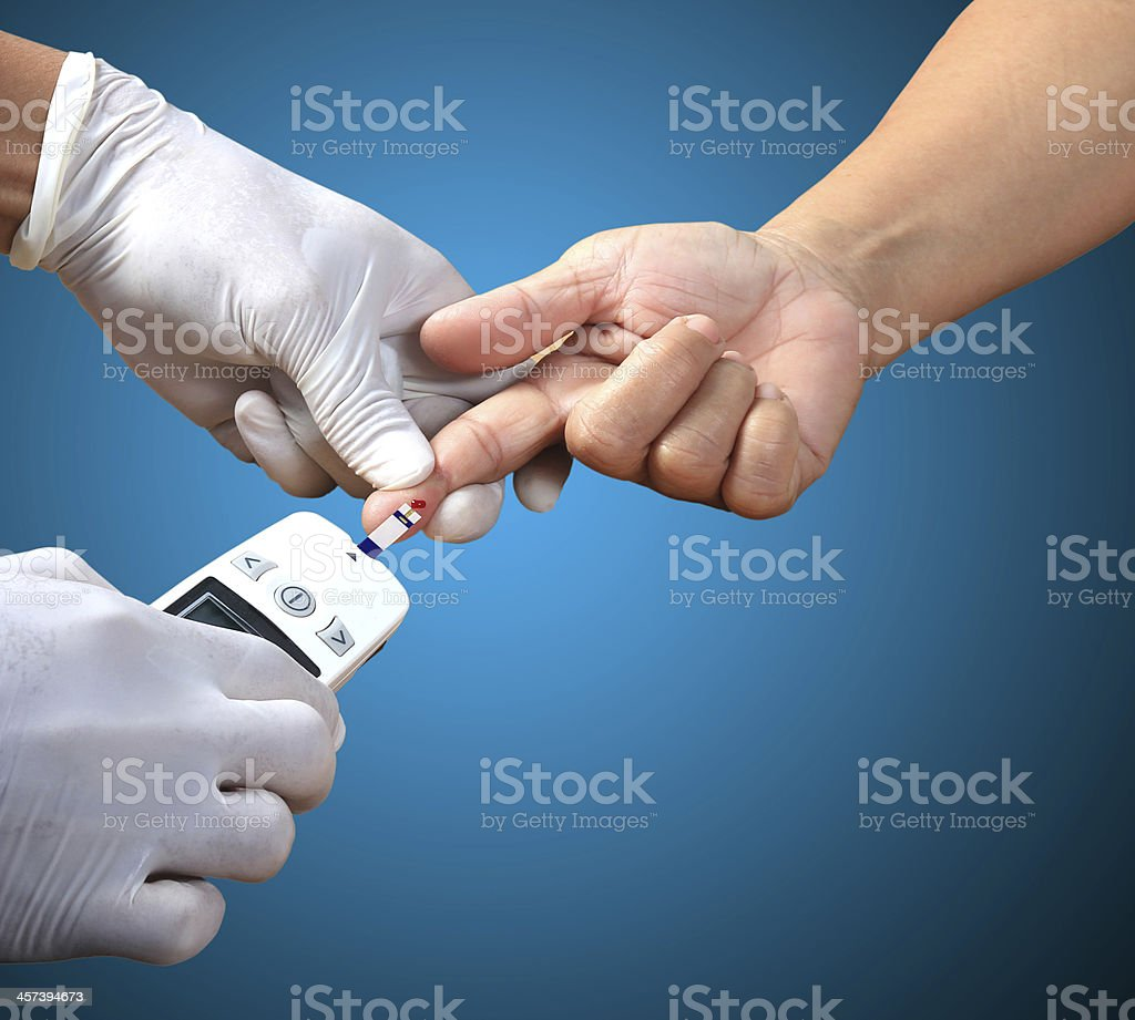 Doctor testing blood sugar value is measured on a finger stock photo