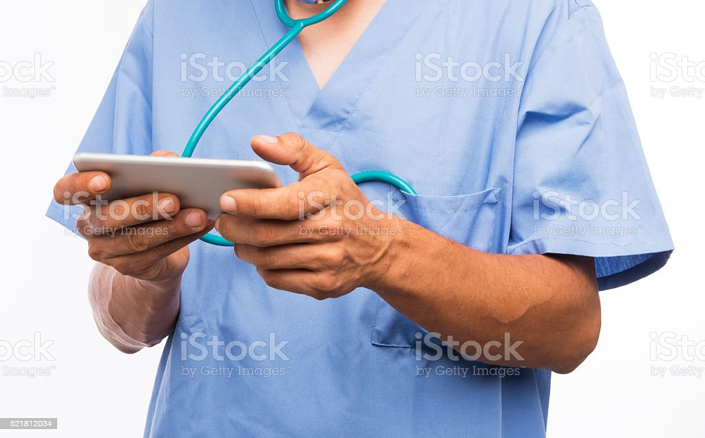 Doctor texting on mobile phone stock photo