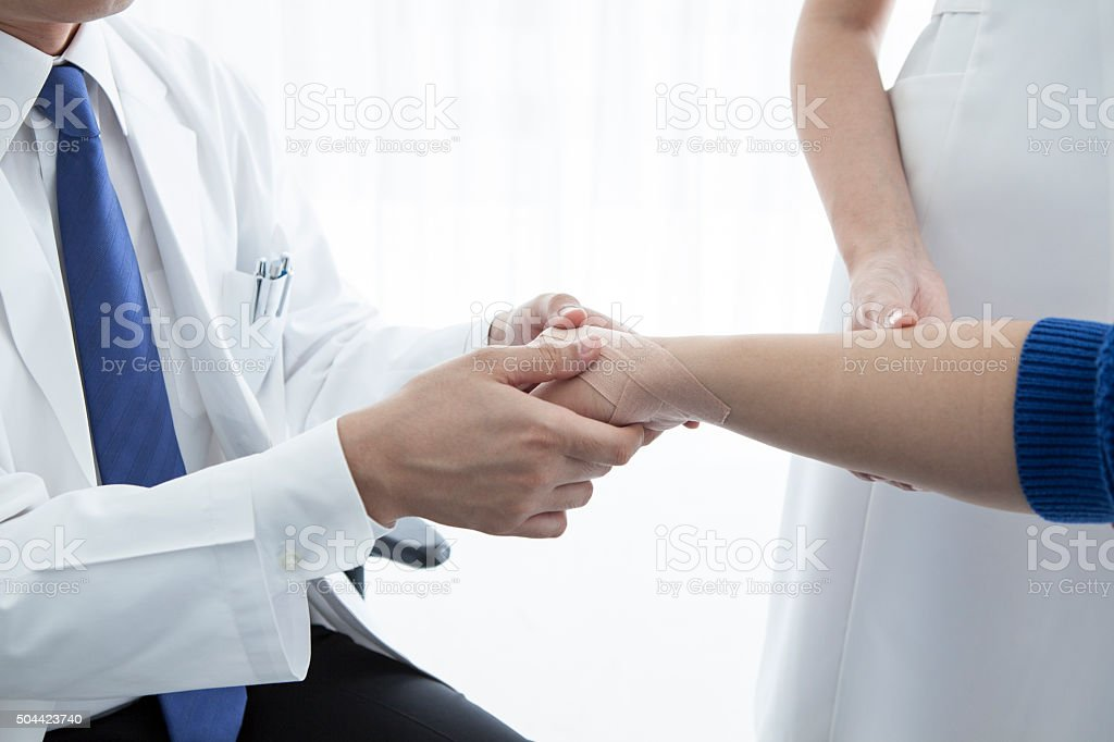 Doctor to massage the handDoctor to massage the hand stock photo