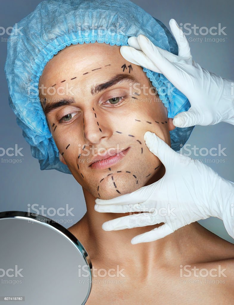 Doctor touches the man's face stock photo