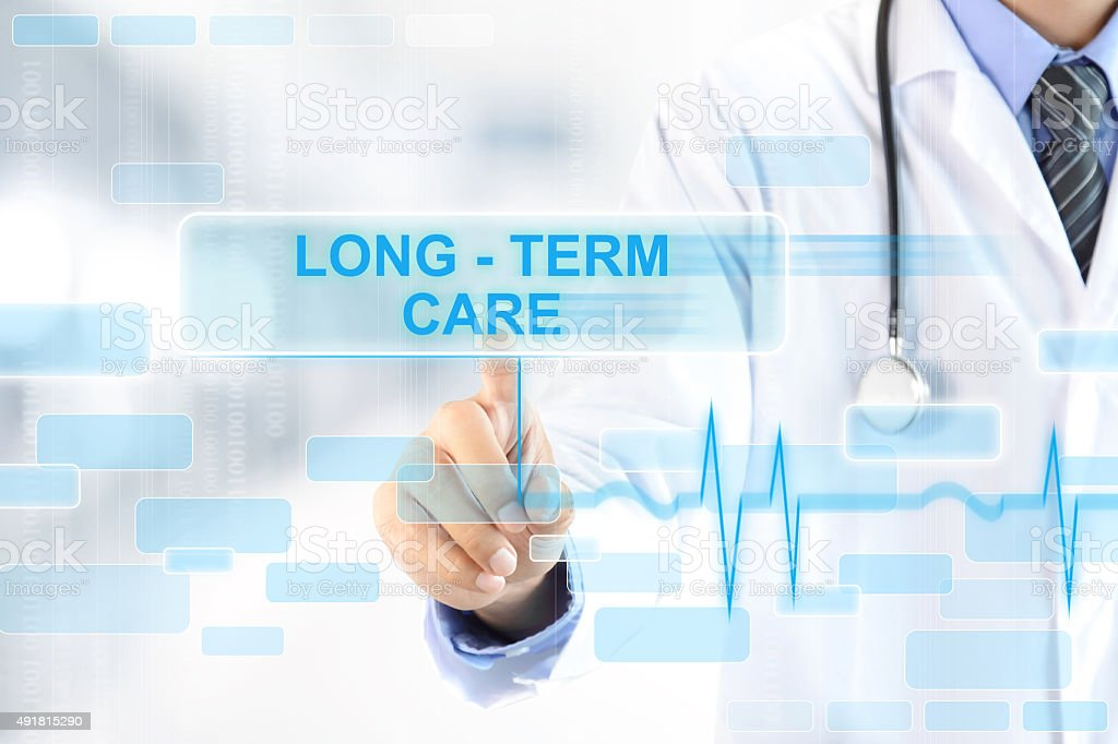 Doctor touching LONG - TERM CARE sign on virtual screen stock photo