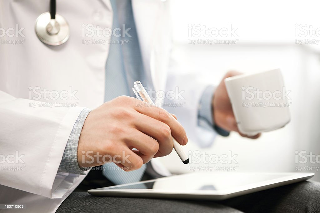 Doctor touching screen digital tablet stock photo