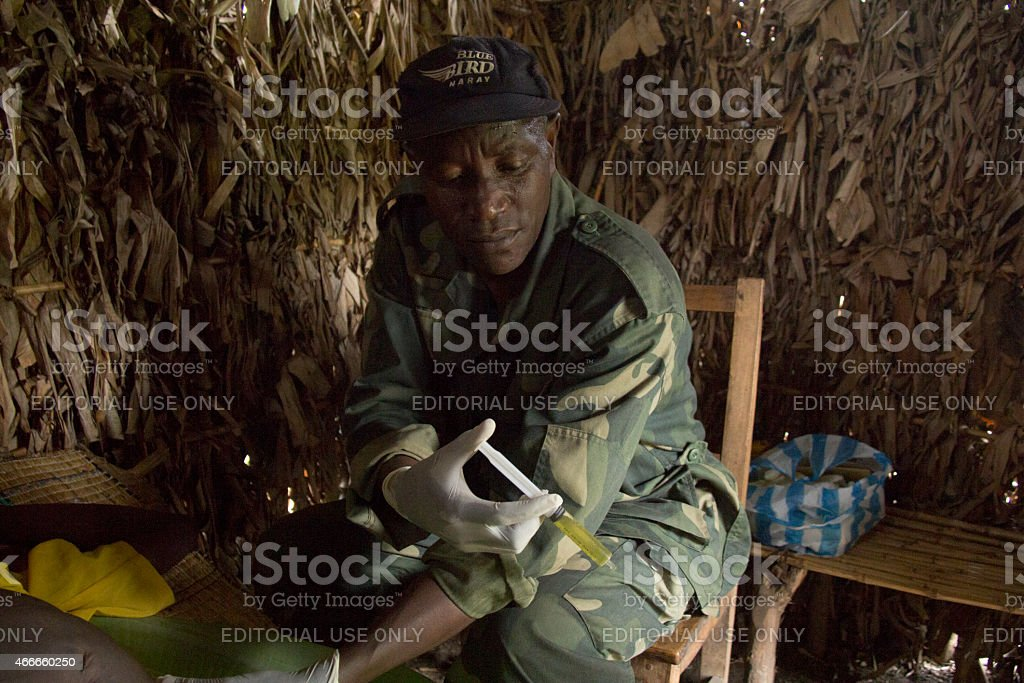 FDLR doctor treating a patient in DR Congo stock photo