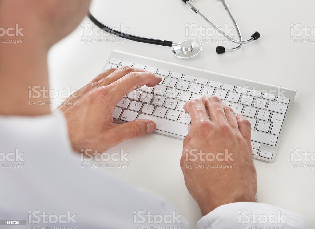 Doctor Typing On Keyboard royalty-free stock photo