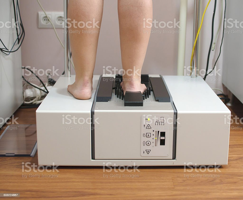 Doctor using 3D scanner system to map patient's foot stock photo
