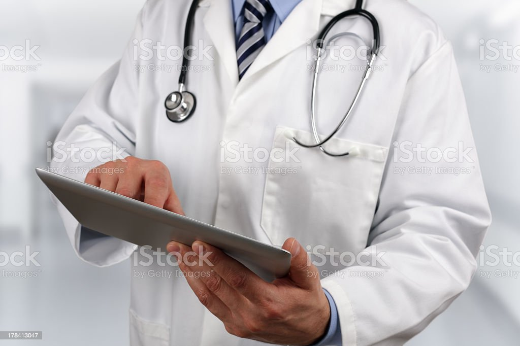 Doctor using a digital tablet in the hospital stock photo