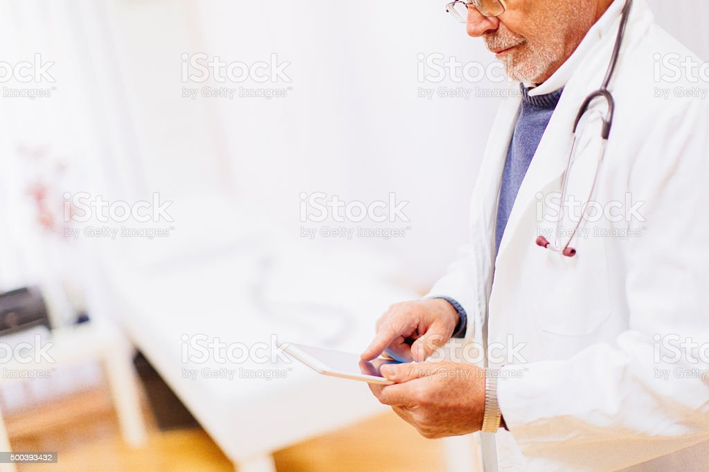 Doctor using a digital tablet stock photo