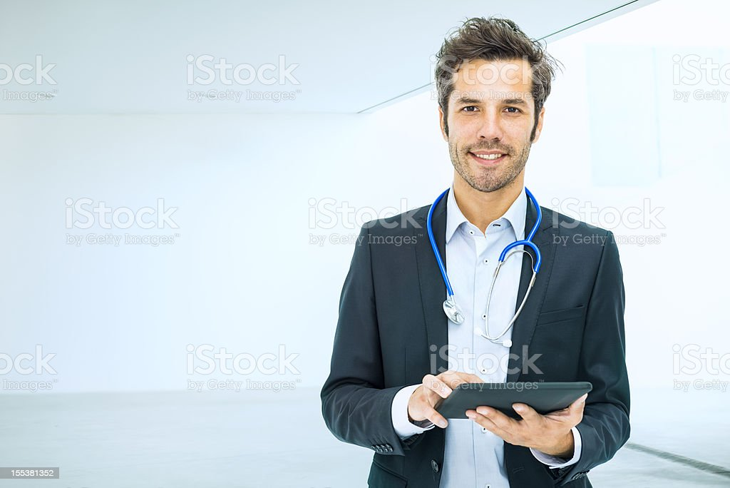 Doctor using digital tablet in hospital stock photo
