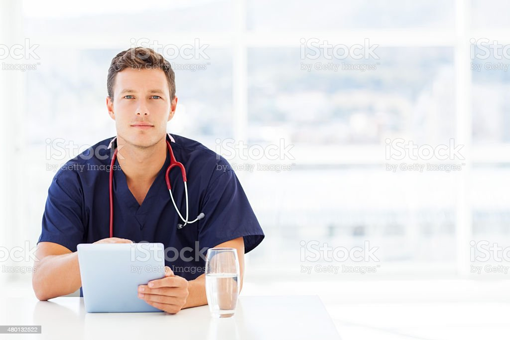Doctor Using Digital Tablet In Hospital stock photo