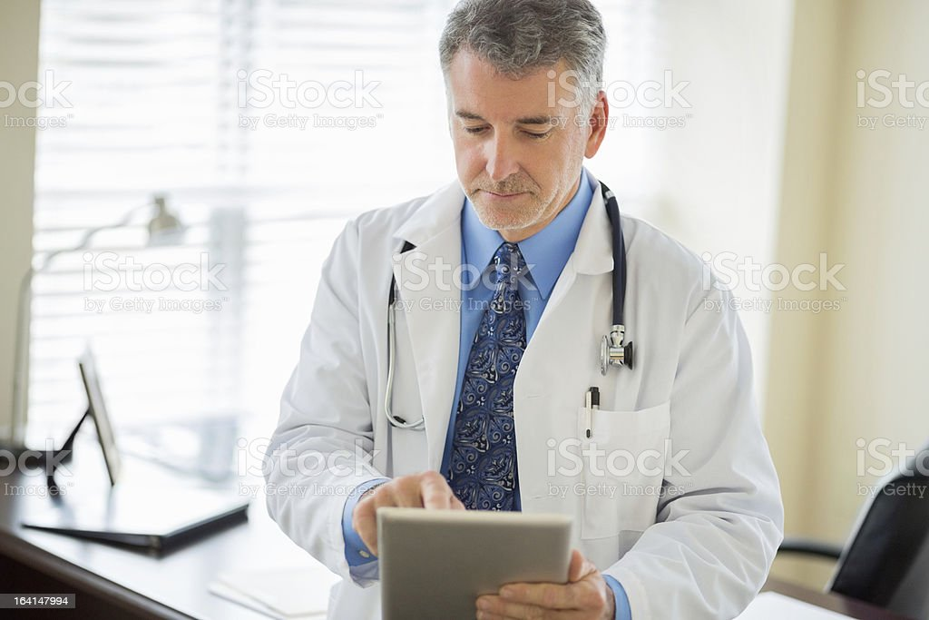 Doctor Using Digital Tablet royalty-free stock photo